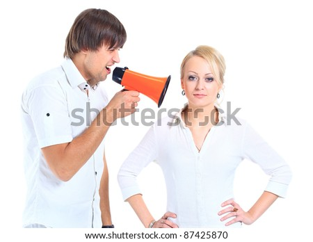 Young woman gets earful from an annoyed man isolated on white background - stock photo
