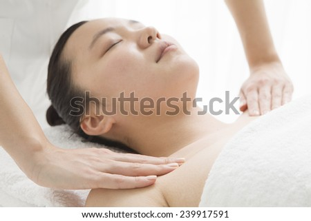 Young woman getting a face massage