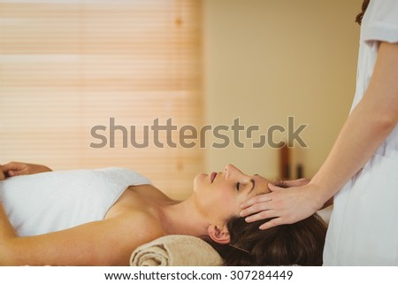 Young woman getting a massage in therapy room - stock photo