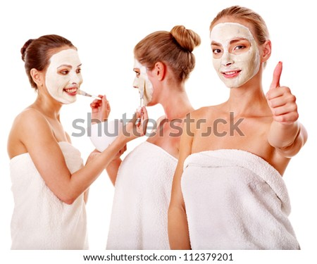 Young woman getting facial mask and gossip . Isolated.
