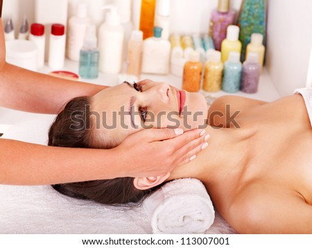 Young woman getting facial  massage in spa. - stock photo