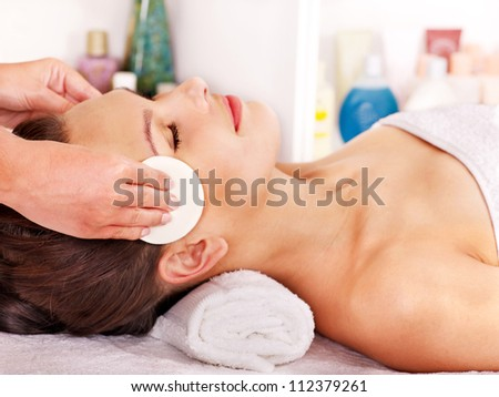 Young woman getting facial  massage in spa salon. - stock photo