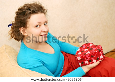 young woman getting gift in red box - stock photo