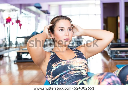 Young woman getting into shape with one more training session