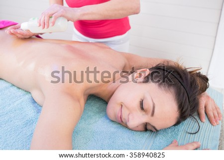Young woman getting massage in a spa.