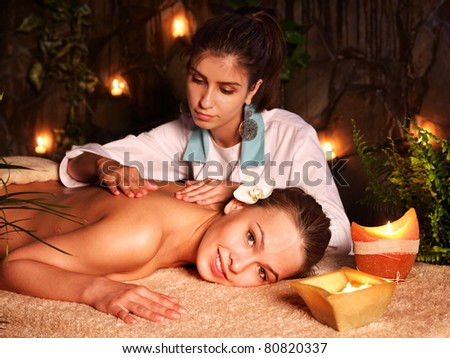 Young woman getting massage in luxury spa. - stock photo