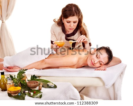 Young woman getting spa treatment .  Isolated. - stock photo