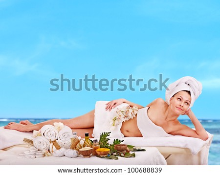 Young woman getting spa treatment outdoor.
