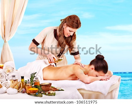 Young woman getting spa treatment outdoor. - stock photo