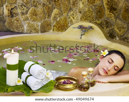 Young woman getting treatment at spa centre - stock photo