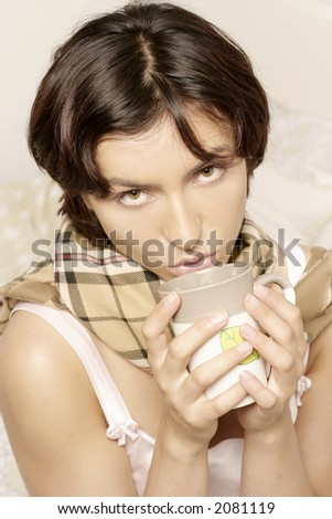 young woman, girl in a scarf drinking from a mug