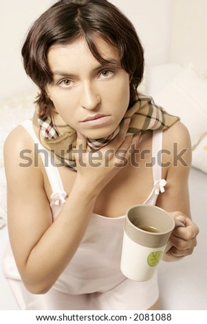 young woman, girl in a scarf drinking tea from a mug - stock photo