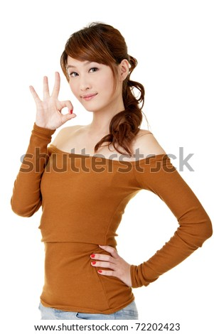 Young woman give you ok gesture, closeup portrait on white background. - stock photo