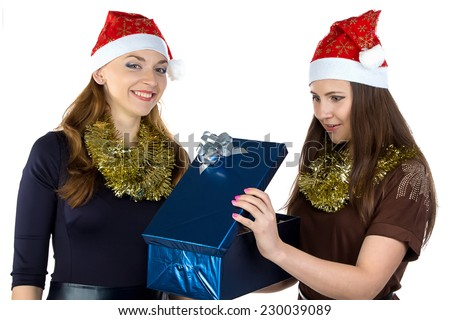 Young woman gives the gift another woman on white background