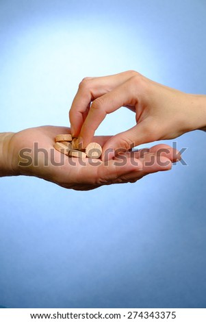 Young woman giving elderly woman pills - stock photo