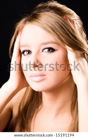 Young woman glamour portrait. On dark background. - stock photo