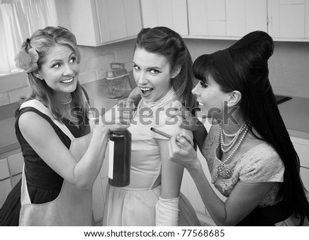 Young woman goes along with friends to smoke and drink in a kitchen - stock photo