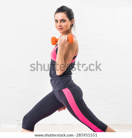 Young woman goes in for sports, fitness with dumbbells. Healthy lifestyle. Health. - stock photo