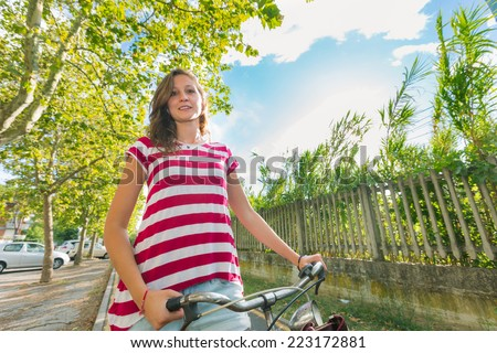 Young Woman Going by Bike, Sustainable Commuting - stock photo