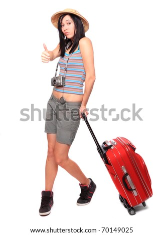 Young woman going on vacation with camera and her suitcase. - stock photo
