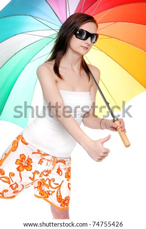 Young woman going on vacation with her rainbow umbrella.