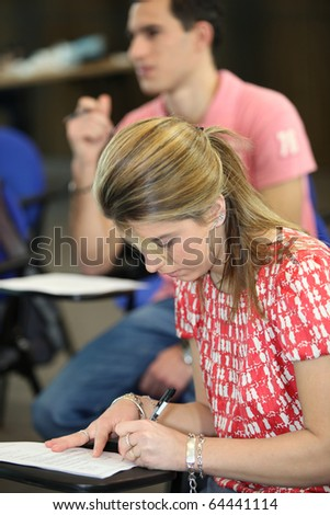 Young woman going to university - stock photo