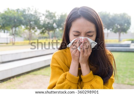 Young Woman got flower allergy - stock photo
