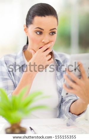 young woman got totally surprised when finish calculating her debts  - stock photo