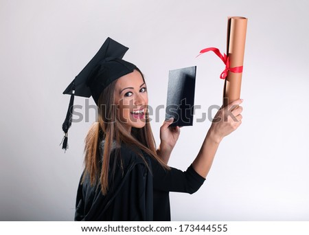 Young woman graduated University - stock photo