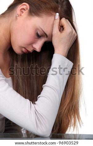 Young woman grieved - stock photo