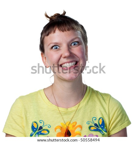Young woman grinning wildly to the camera - stock photo