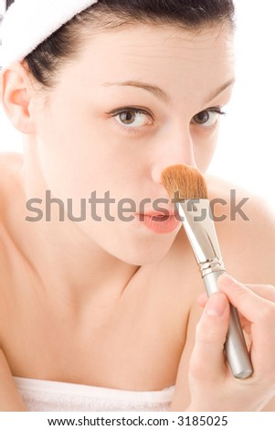 young woman grooming her self - stock photo