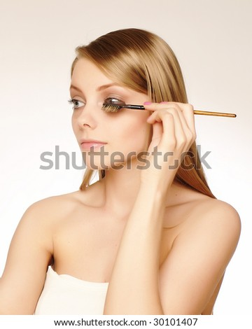 young woman grooming herself - stock photo