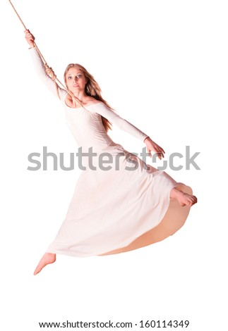 Young woman gymnast in white dress on rope. White background  - stock photo