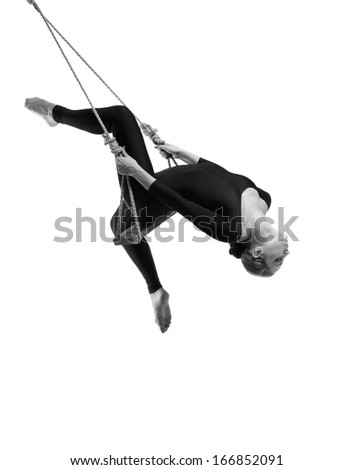 Young woman gymnast on rope on white background , Black and white