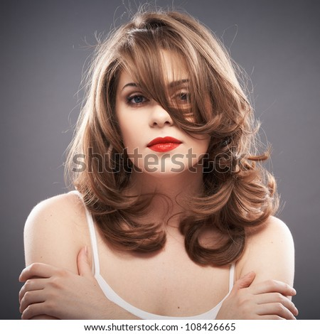 Young woman hair style portrait . isolated on gray background - stock photo