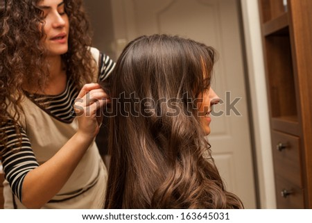 young woman hairdo at hairdressing salon - stock photo