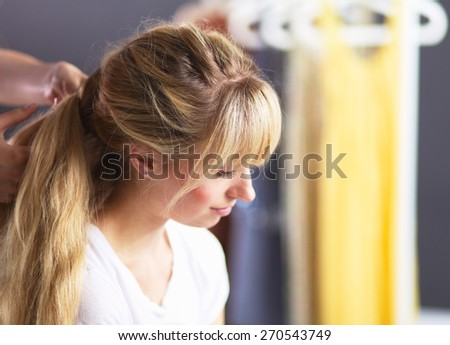 Young woman hairdresser do hairstyle girl in salon - stock photo