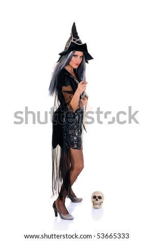 Young woman, Halloween witch with scary expression. Studio, white background.