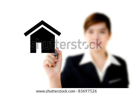 Young woman hand drawing house in a whiteboard. - stock photo