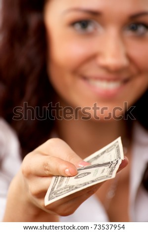 Young woman hand holding one dollar, selective focus