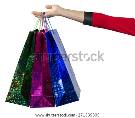 Young woman handing the colorful shopping bags. Isolated background
