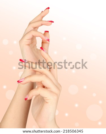 Young woman hands with elegance manicure on bright background - stock photo