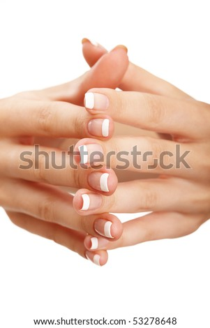 "Young woman hands with natural (""french"") manicure over isolated white background"