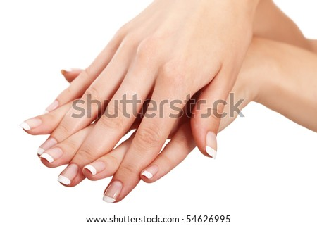 """Young woman hands with natural """"french"""" manicure over isolated white background - stock photo"""