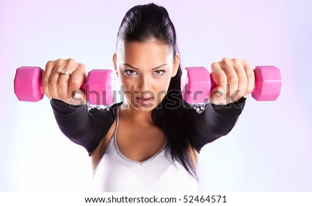 Young woman hang up hands weights ,studio shot - stock photo