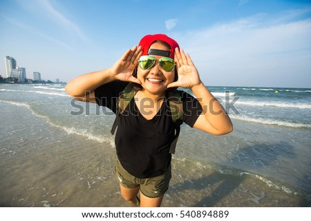 young woman happy at the sea beach at sunny day. subject is soft focus