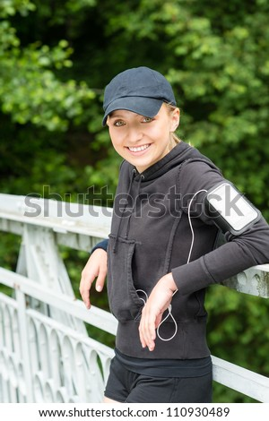 Young woman happy resting after workout sport tired relaxing tracksuit - stock photo