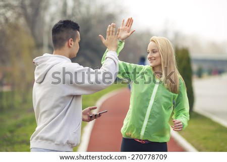 Young woman happy to successfully finish exercise - stock photo