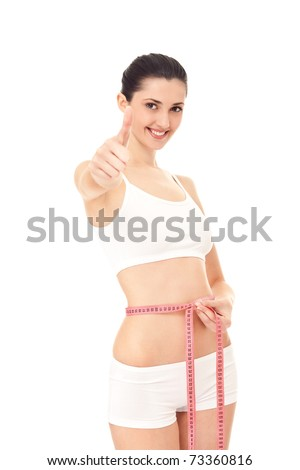 young woman happy with her diet results,  isolated on white - stock photo